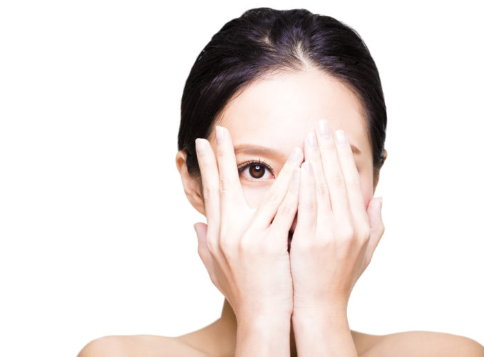 Young,Woman,Covering,Her,Eyes,By,Hands